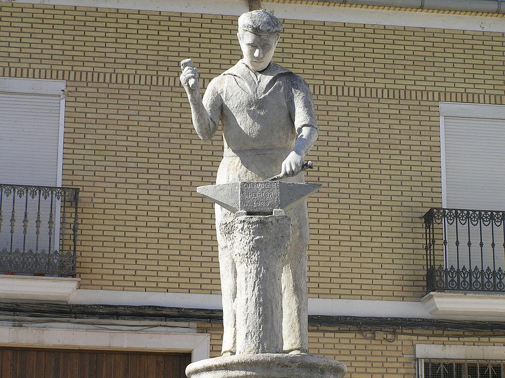 Herrera sevilla escultura el herrero notarios y for Clausula suelo wikipedia
